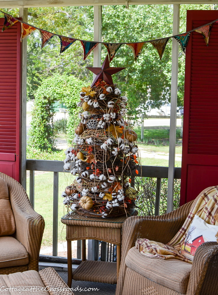 kantha cloth bunting on a fall porch