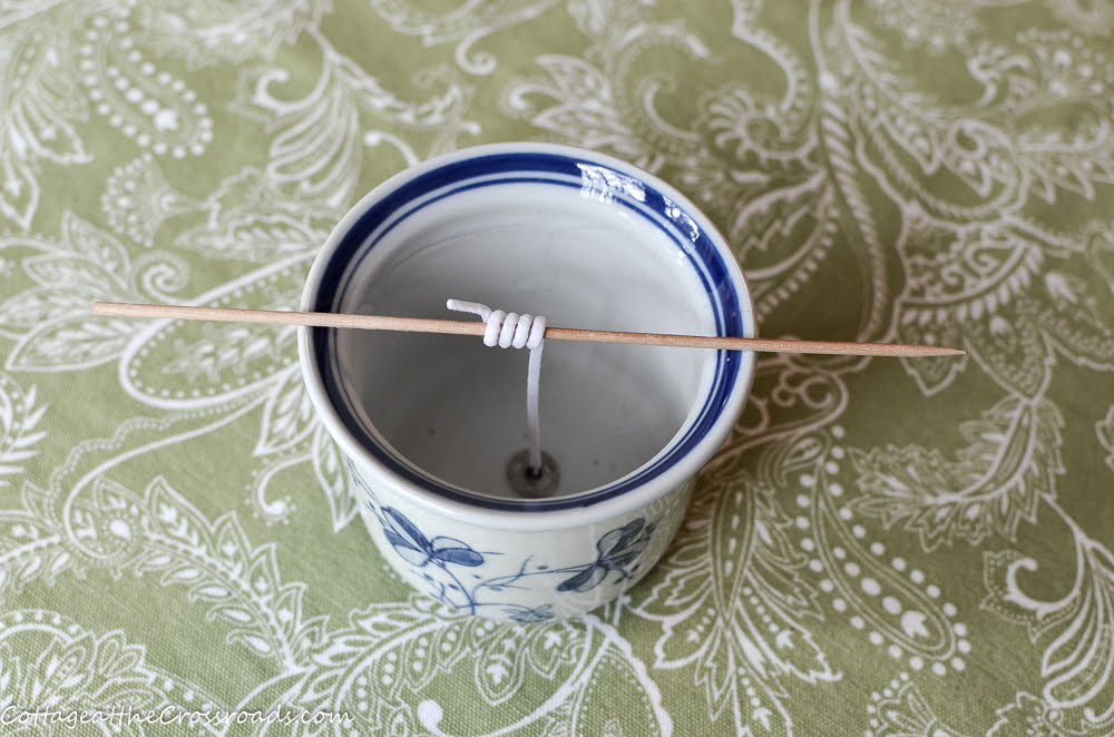 blue and white pot used in making a homemade candle