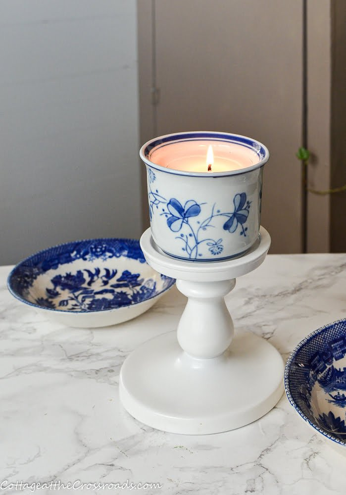 homemade candle in a blue and white pot