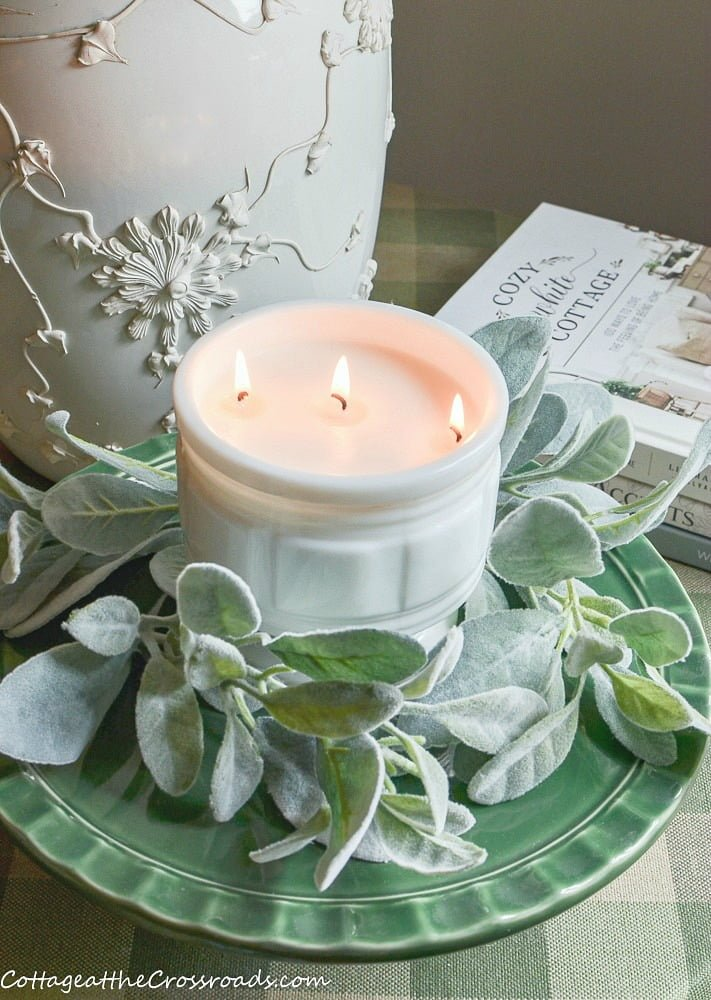 homemade candle in a vintage milkglass container
