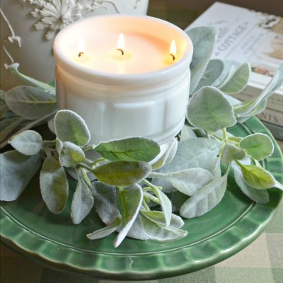 thrifty homemade candle in a vintage milkglass container