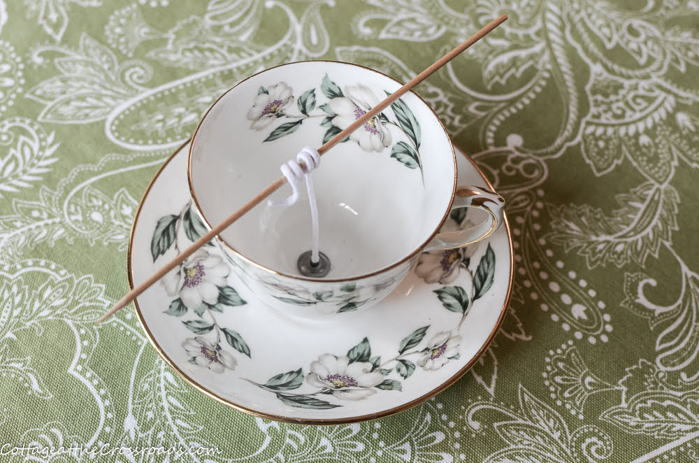 vintage tea cup used in making a homemade candle