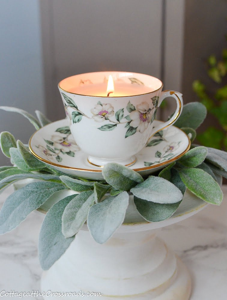 homemade candle in a vintage tea cup