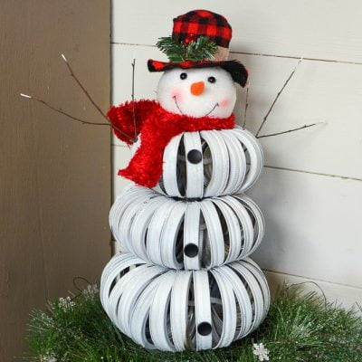 Adorable handmade snowman made with canning jar rings