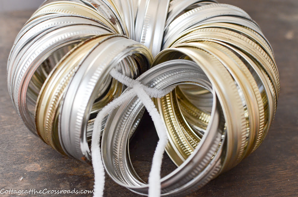 canning rings threaded onto a pipecleaner