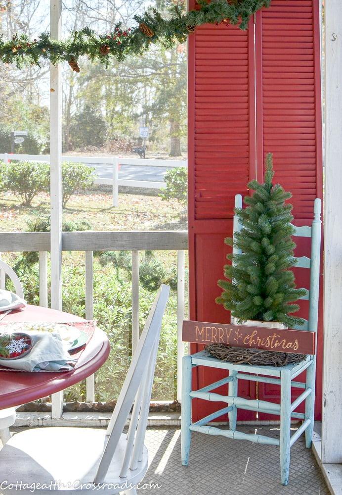 Christmas tree in an aqua chair
