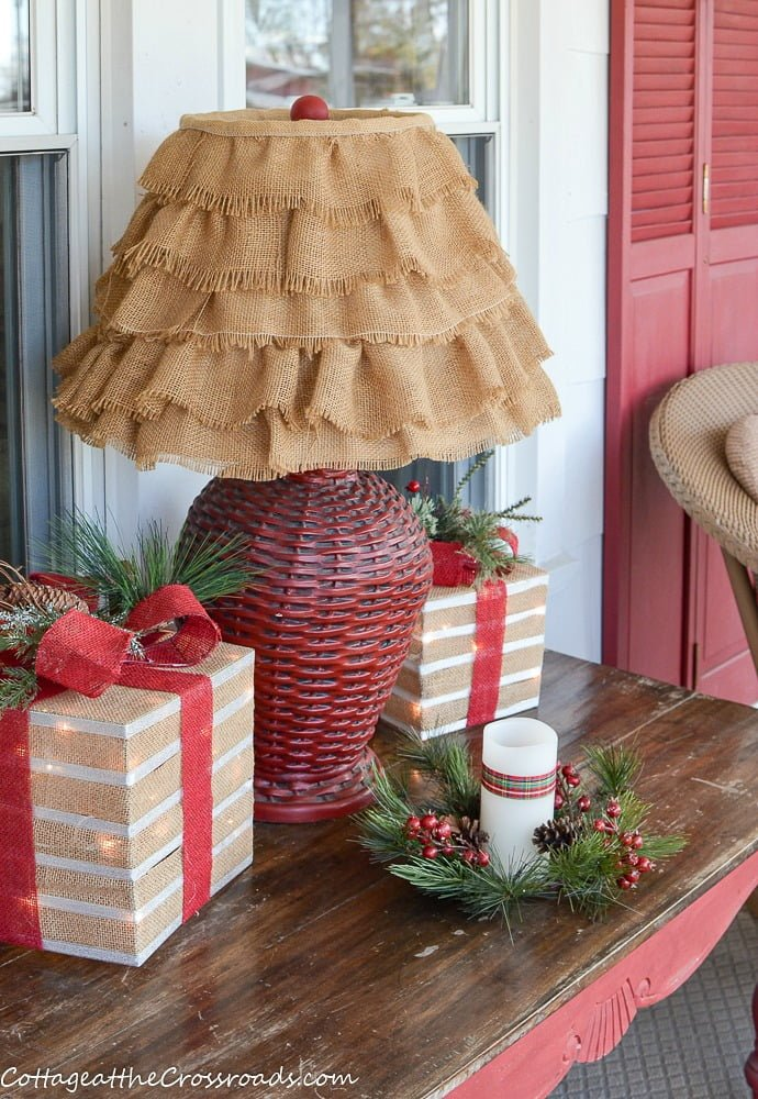 lamp with burlap shade and lighted boxes
