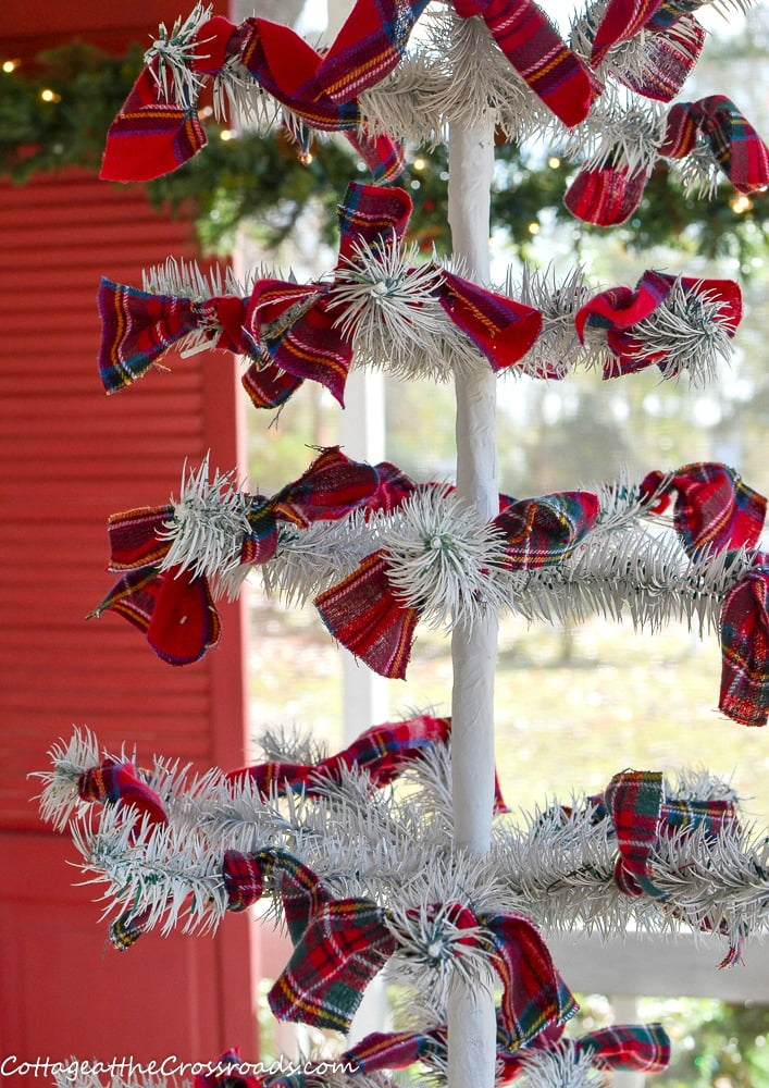plaid bows tied onto a reproduction feather tree