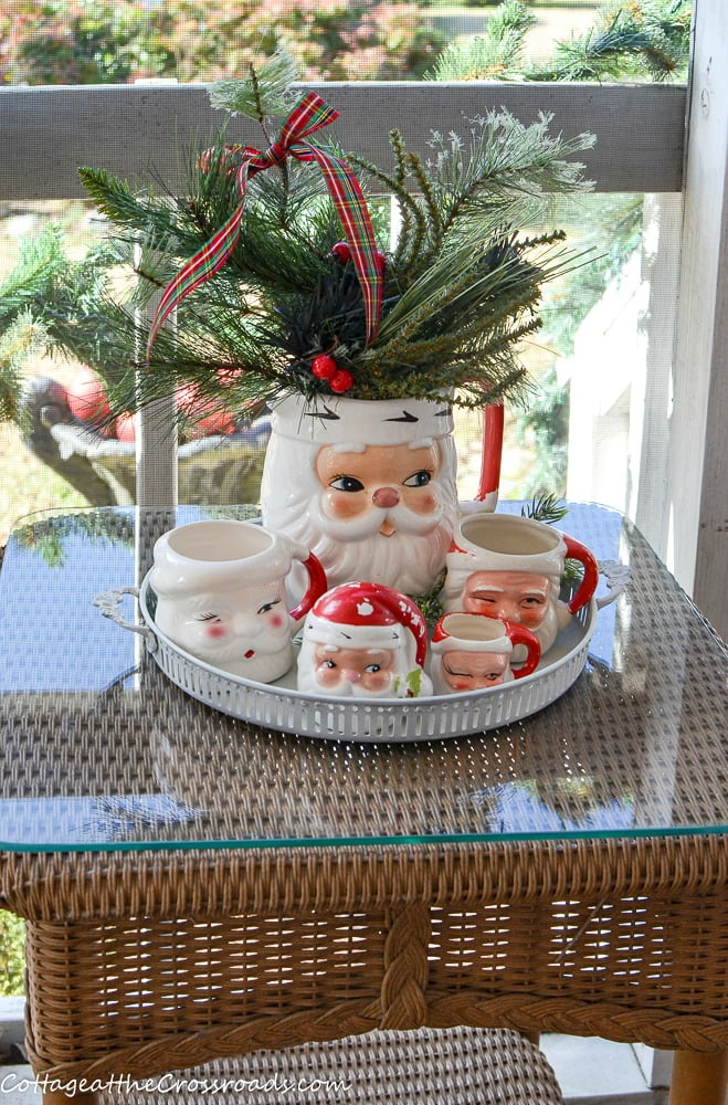 vintage Santa mugs and pitcher on a Christmas porch