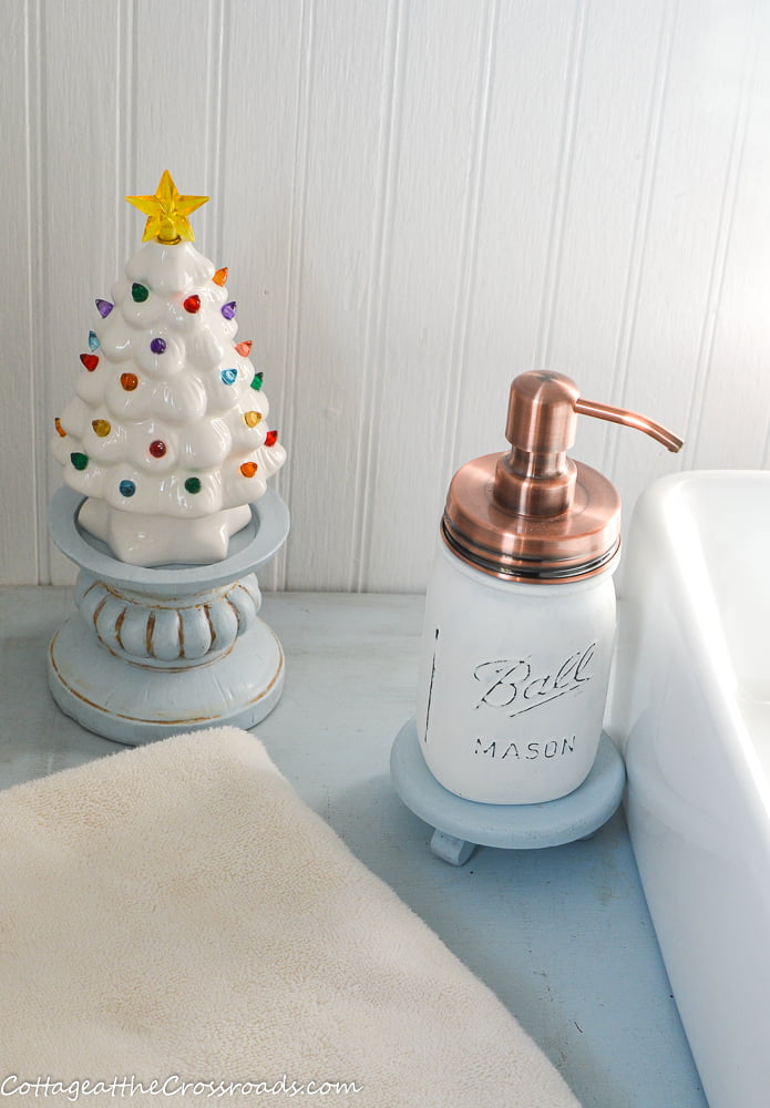 white ceramic tree in Christmas bathroom
