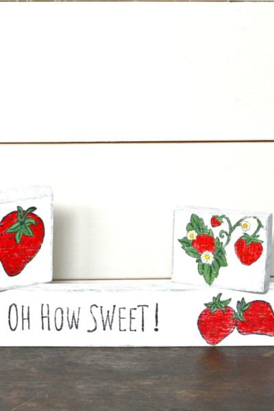 small scrap wood signs with strawberries