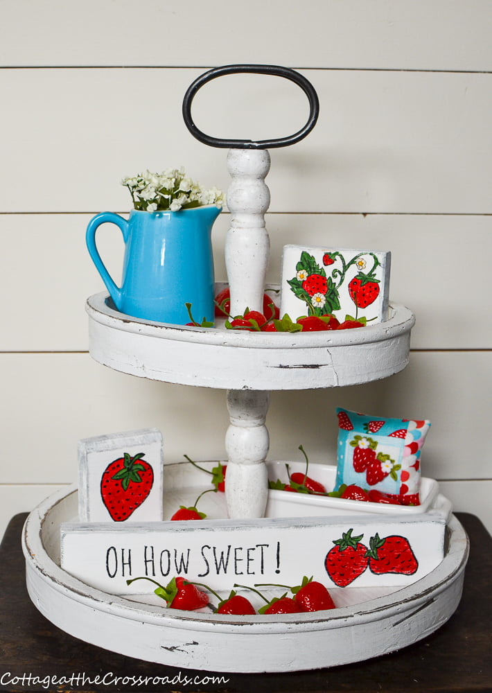 tiered tray with strawberry mini wooden signs
