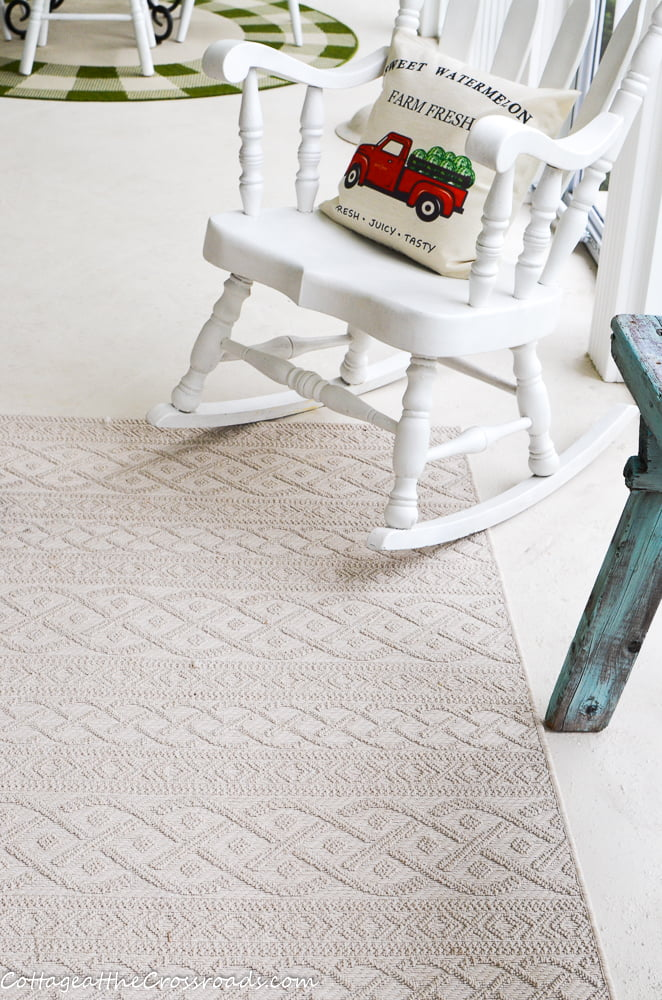 neutral outdoor rug on the screen porch