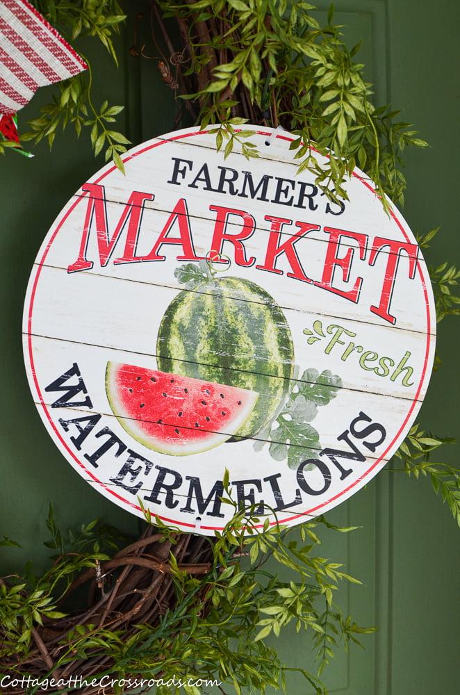 round farmer's market sign on a wreath