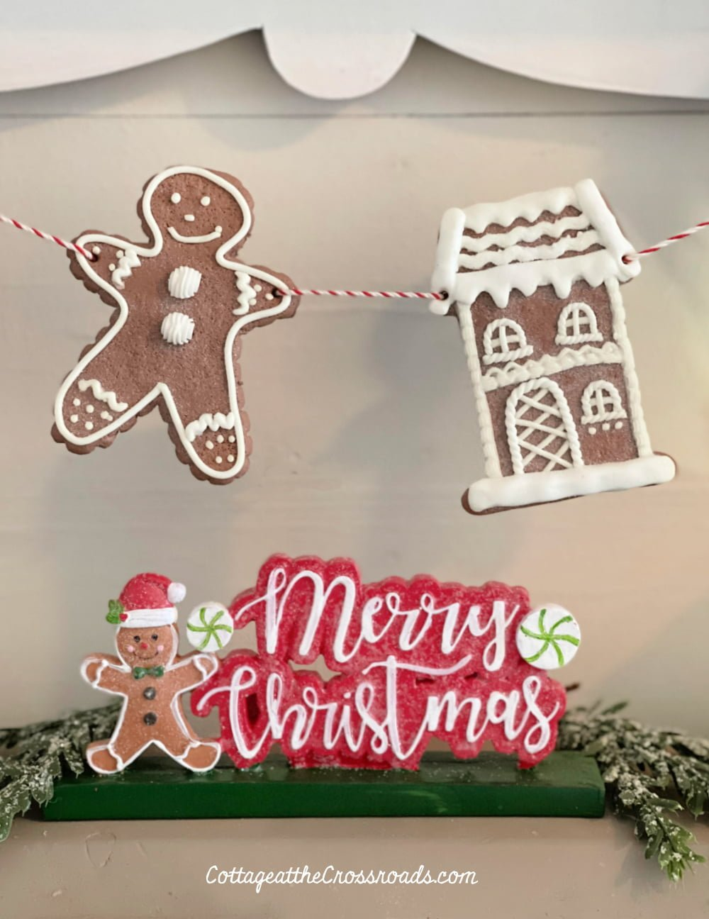 Merry Christmas sign and gingerbread garland