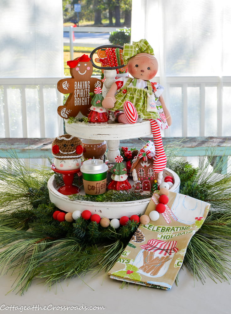 tiered tray decorated with a gingerbread theme