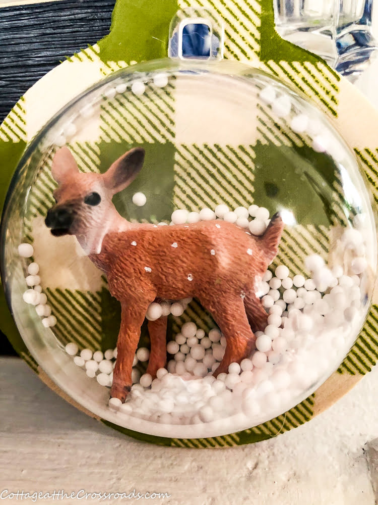 snow globe ornament with deer