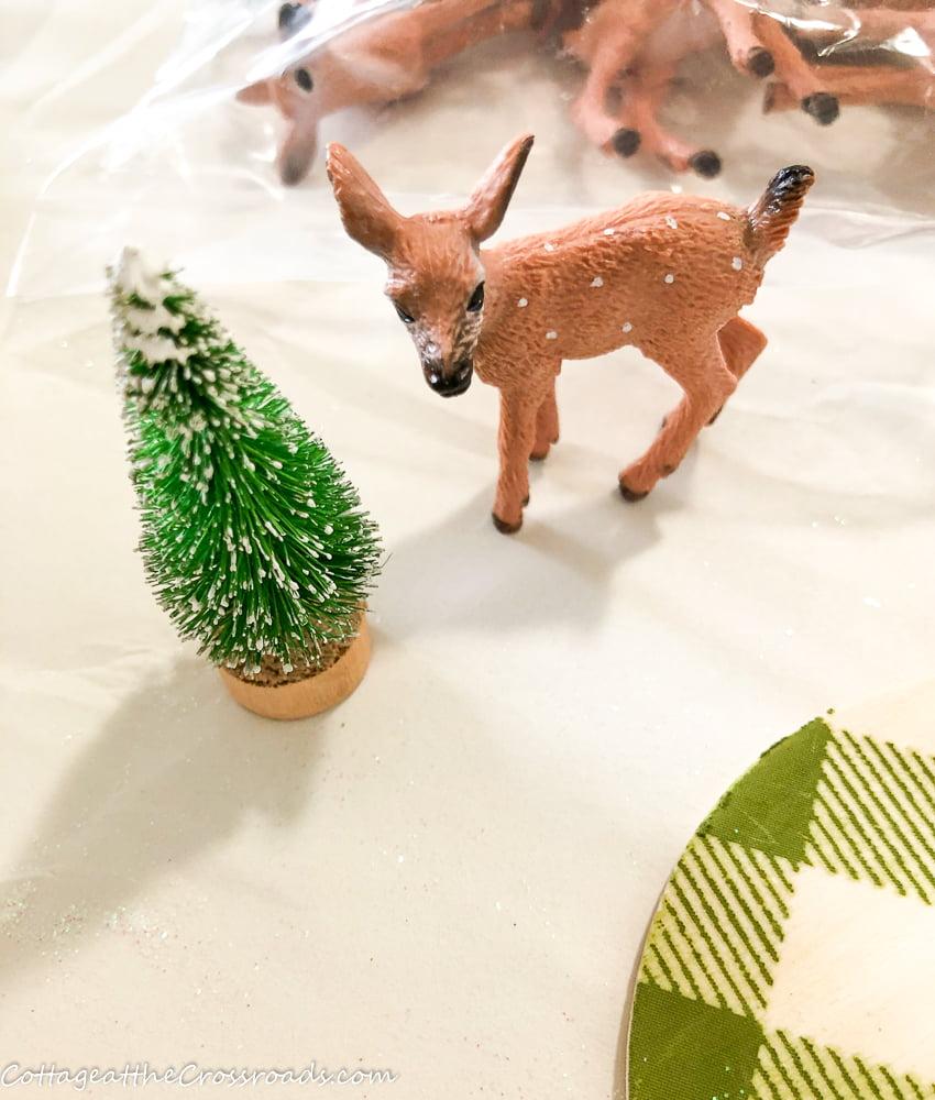 miniature deer and tree
