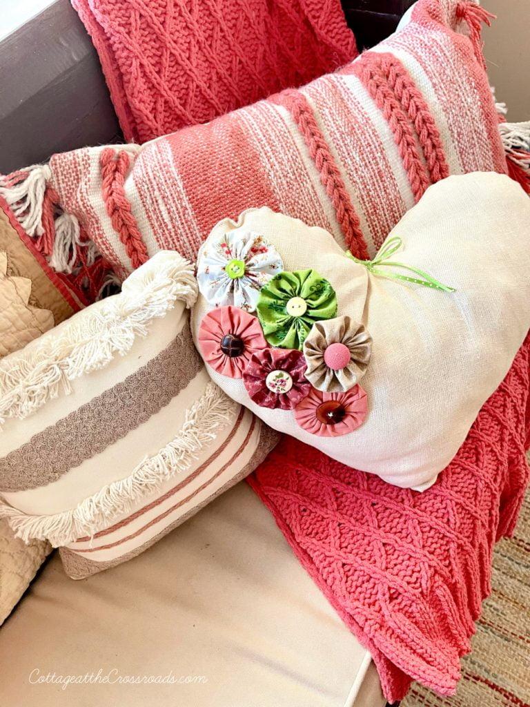 heart shaped pillow with yo-yos