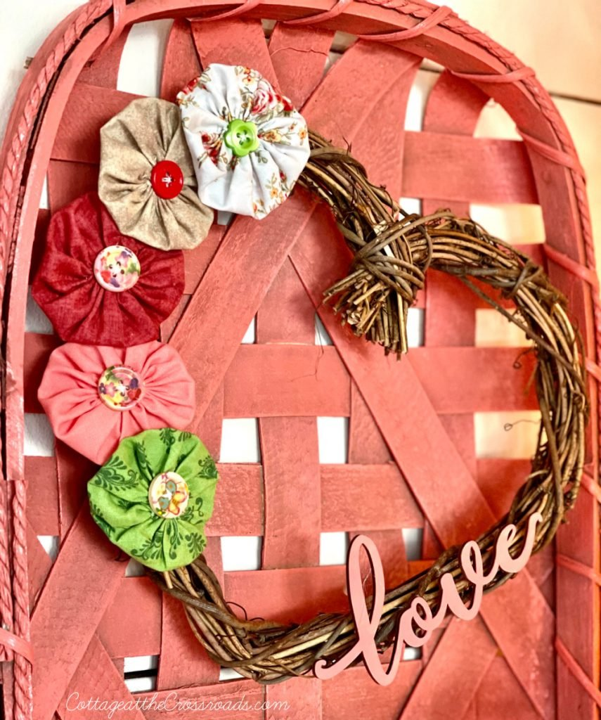 twig heart shaped wreath with yo-yos