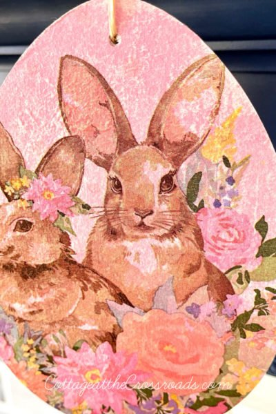 large wooden Easter egg decoupaged with bunnies