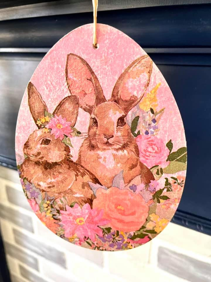 tow bunnies decoupaged onto a wooden Easter egg