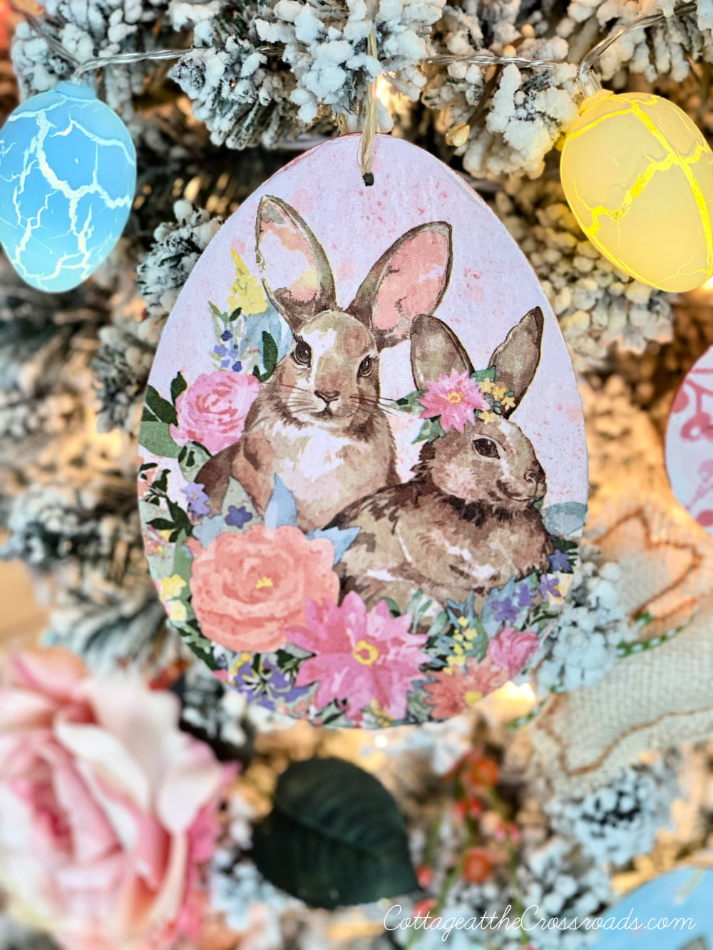 decoupaged bunnies on a wooden Easter egg