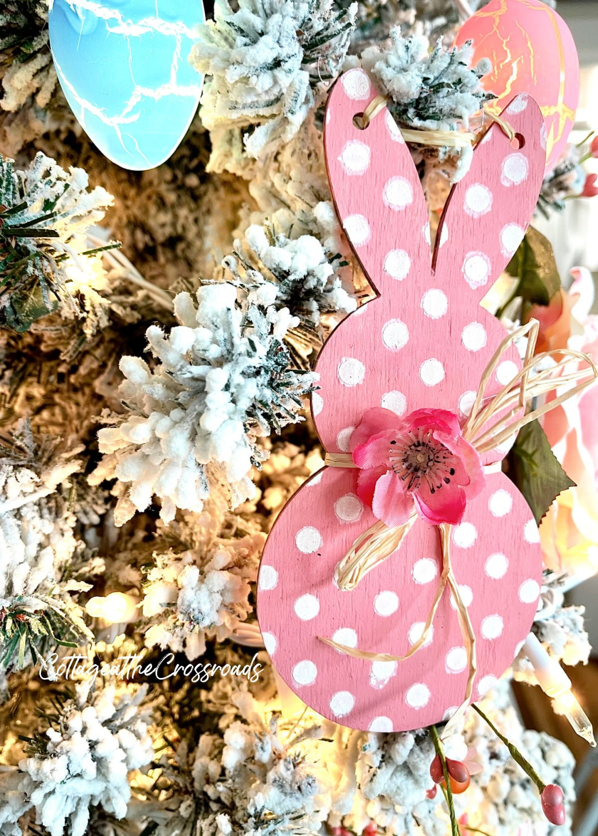 polka dot wooden bunny on a Easter tree