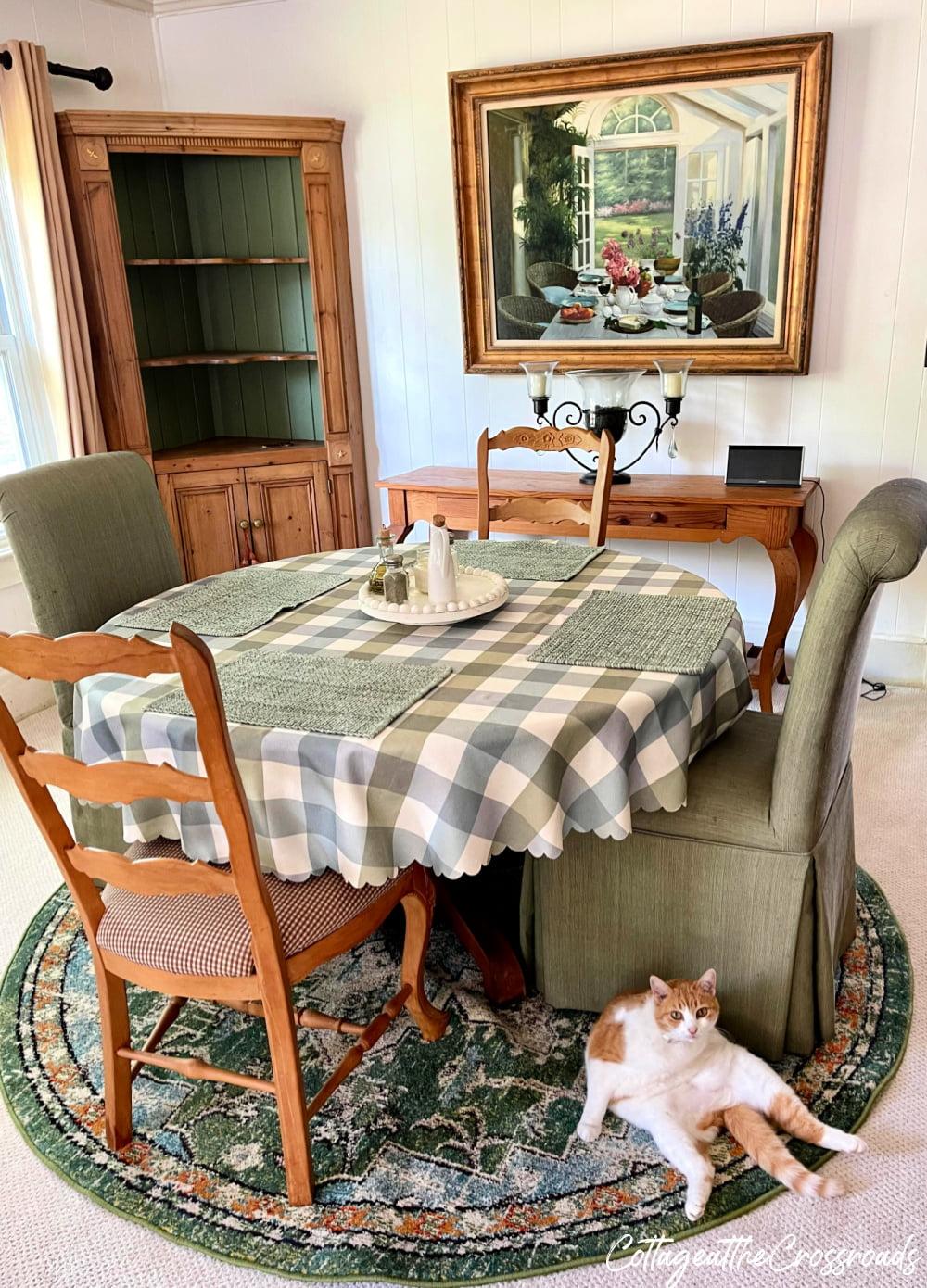 cat on rug near table