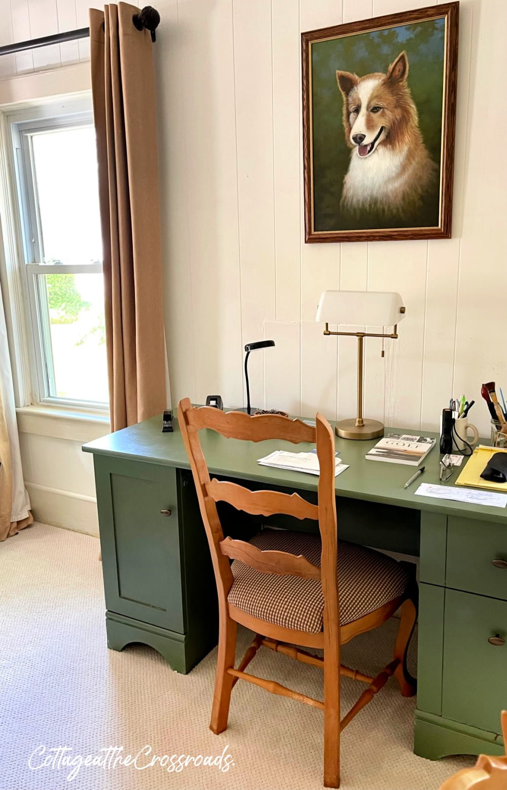 green desk and dog portrait above