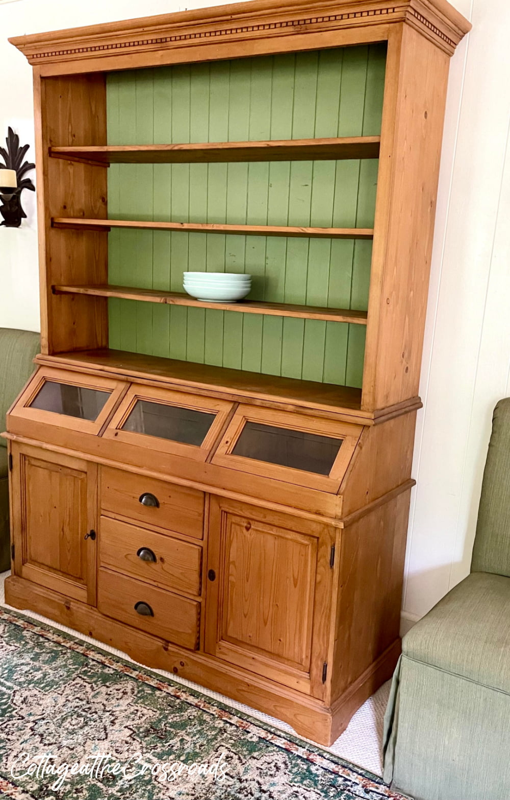 pine cupboard with green back