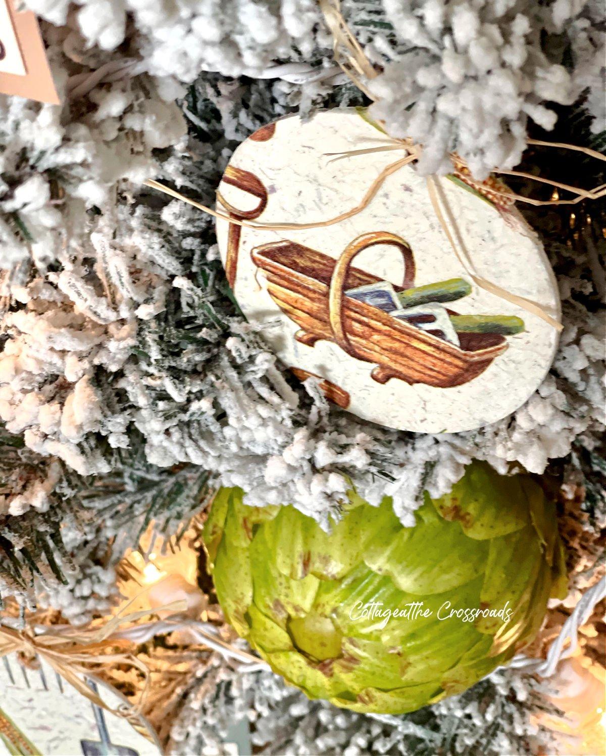 decoupaged round garden theme ornament