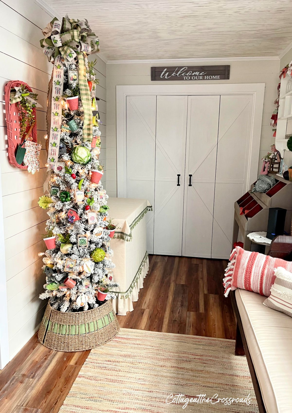 garden theme Christmas tree in the entry