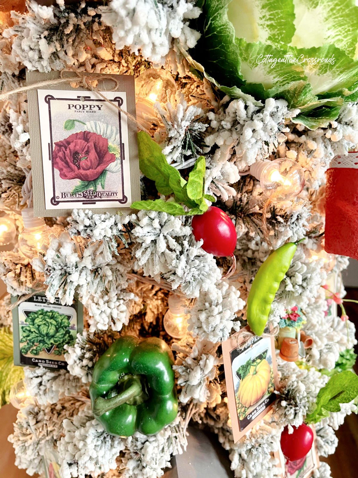 seed packet ornaments and vegetables on a garden tree