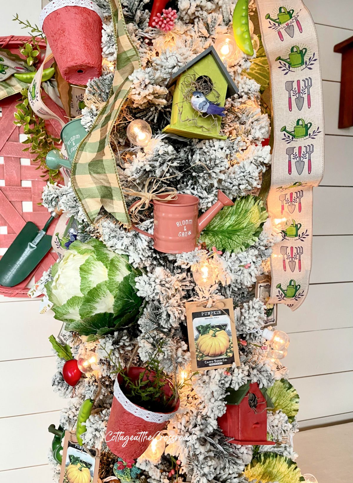 watering can ornament on garden tree