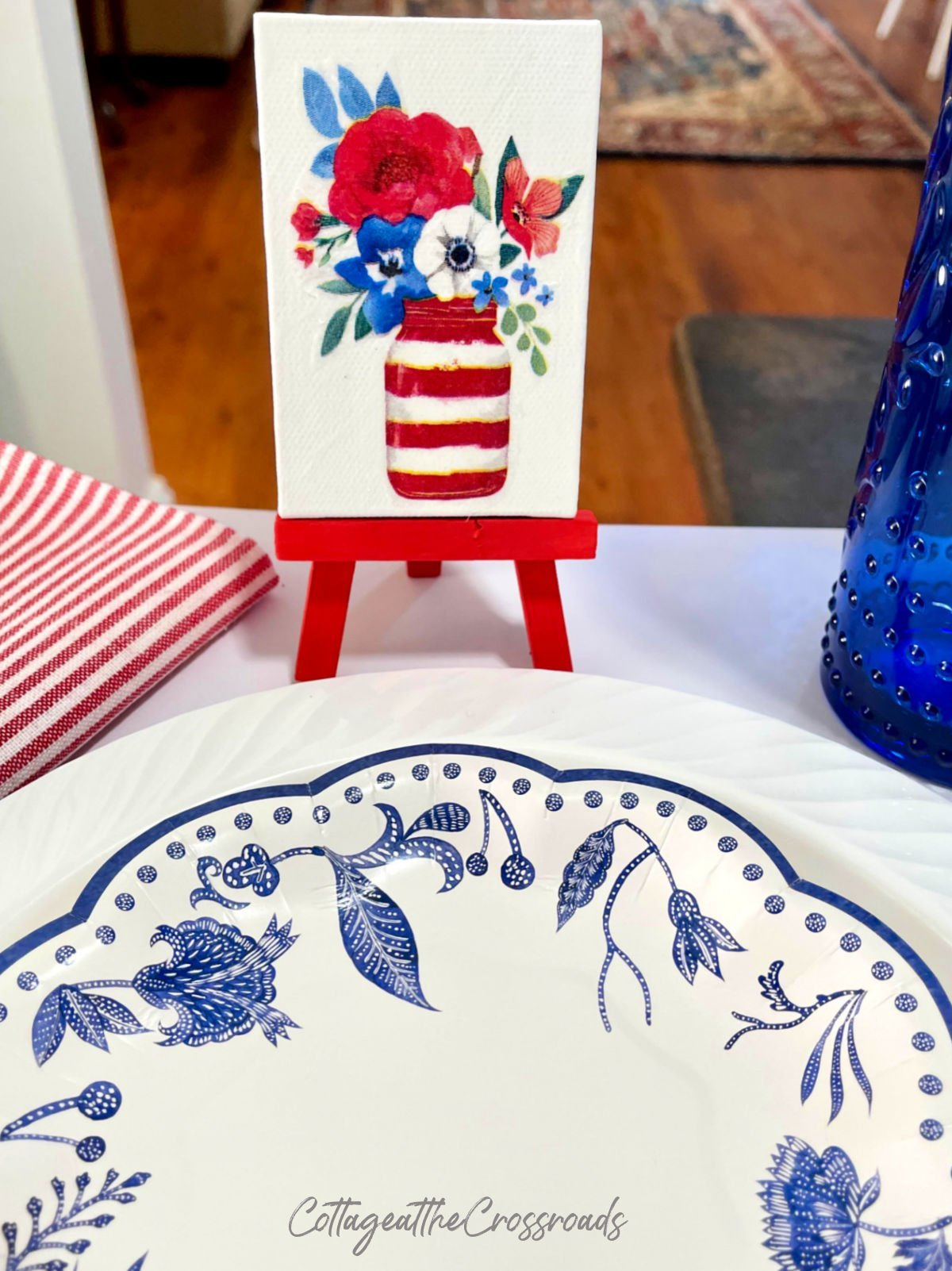 painted mini easels used in a patriotic table setting
