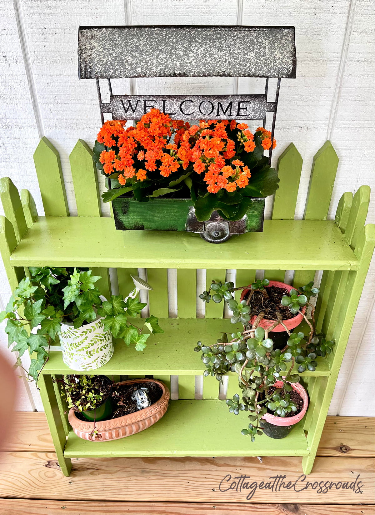 green bookcase with pickets