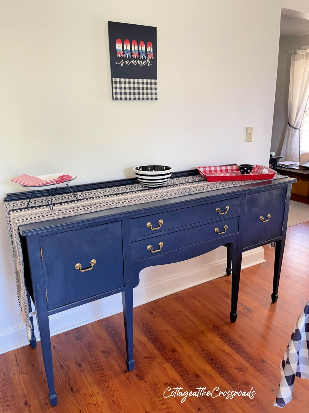 navy buffet with runner on top