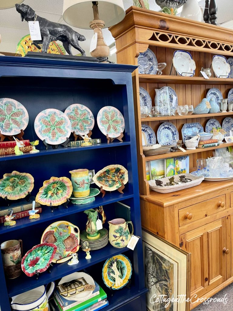 photo of the inside of an antique store with a display of majolica