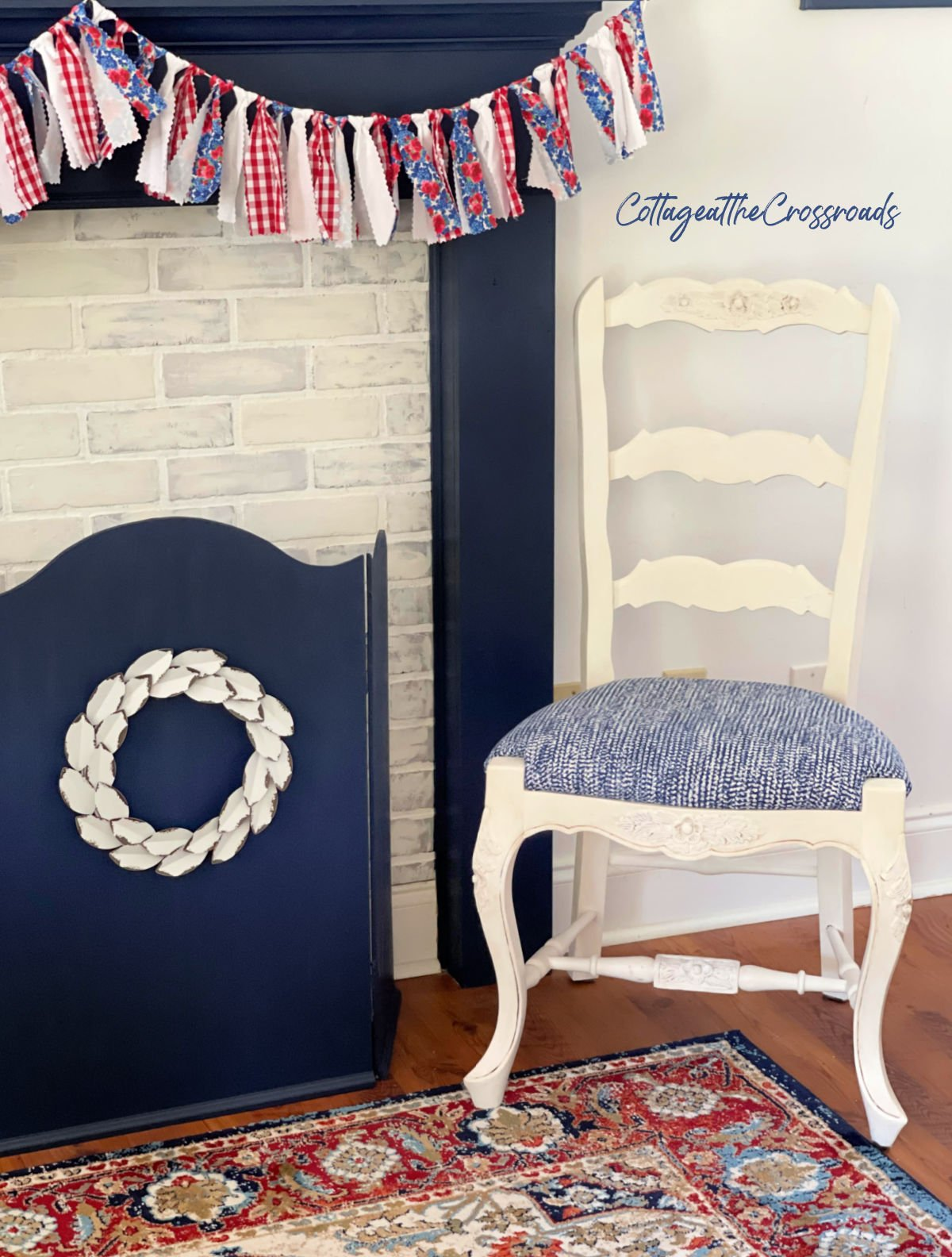 white painted chair beside mantel