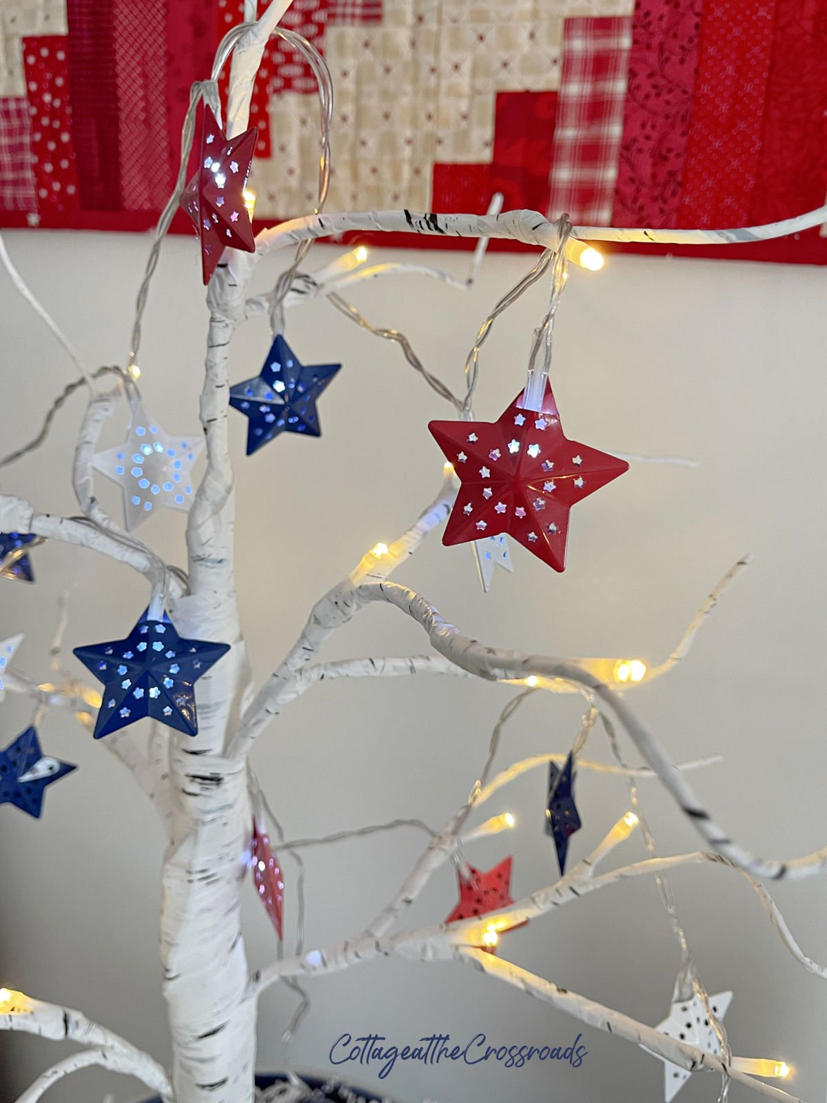 red white and blue star lights on a tree