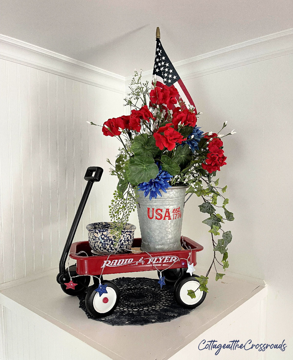 patriotic decor in a little red wagon