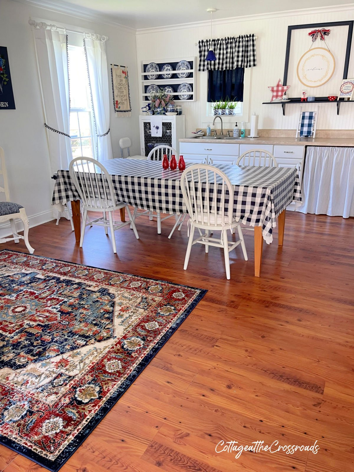 view of craft studio with table and rug