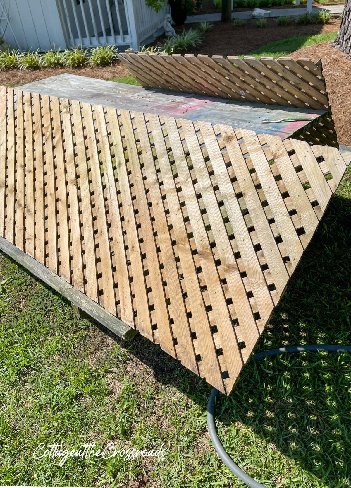 wood lattice panels propped on a picnic table