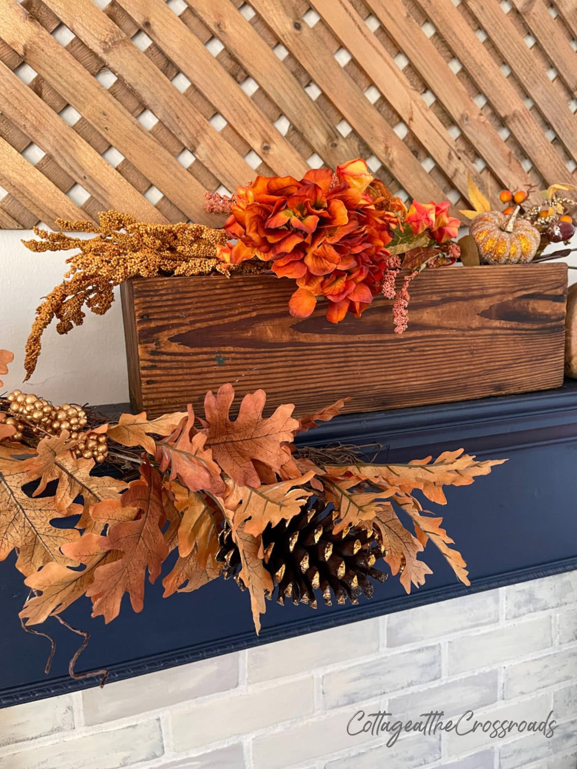 fall garland and florals on a mantel