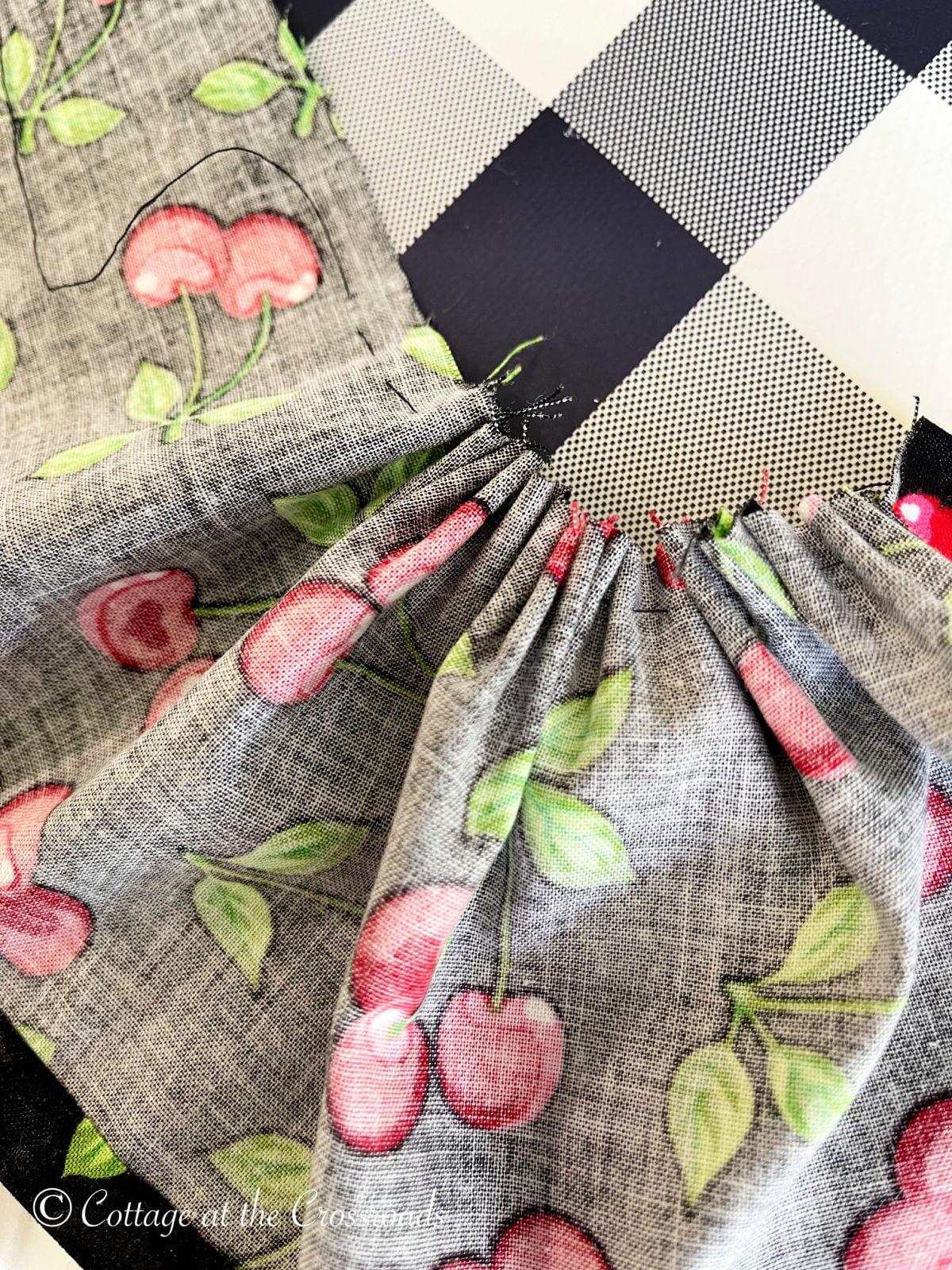 gathering fabric along a basting stitch