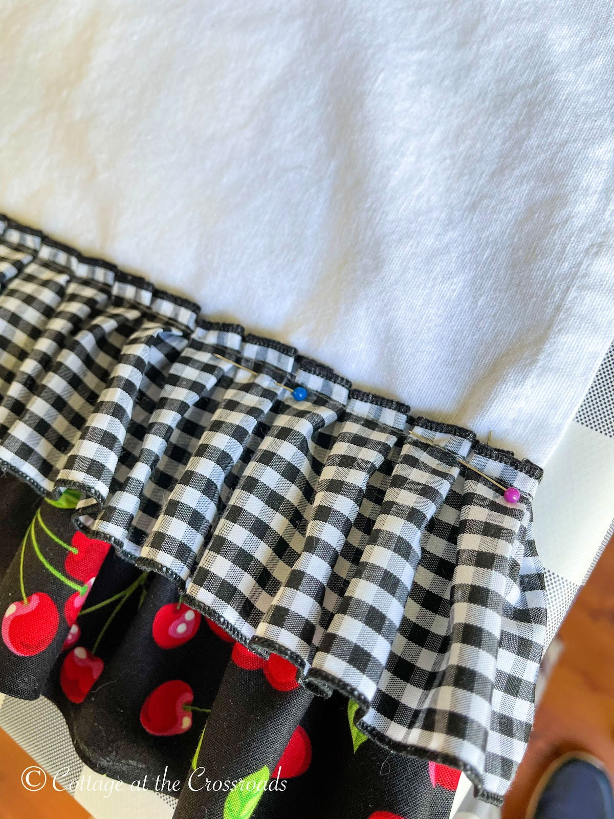 pinned pleated black and white gingham trim