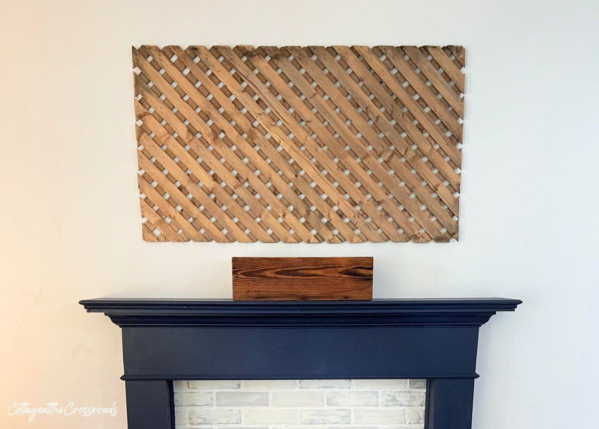 wooden lattice panel mounted above a mantel
