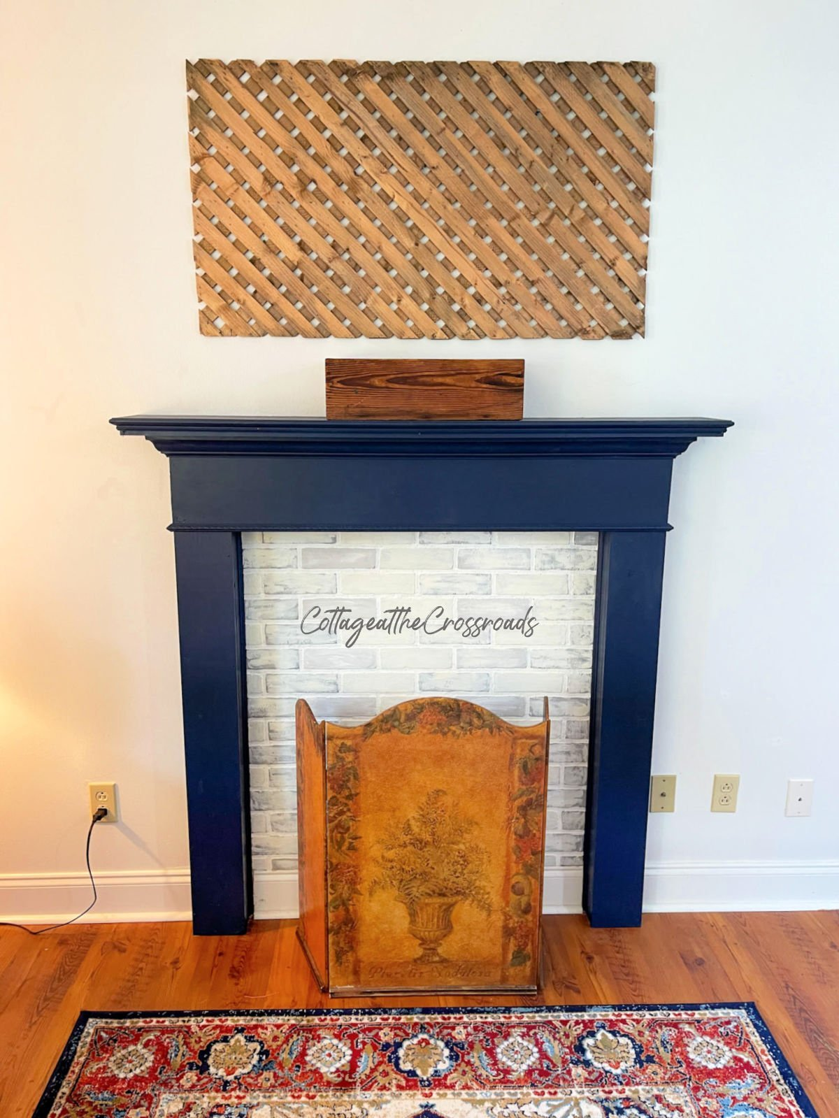 wood lattice panel hanging on the wall over a navy mantel