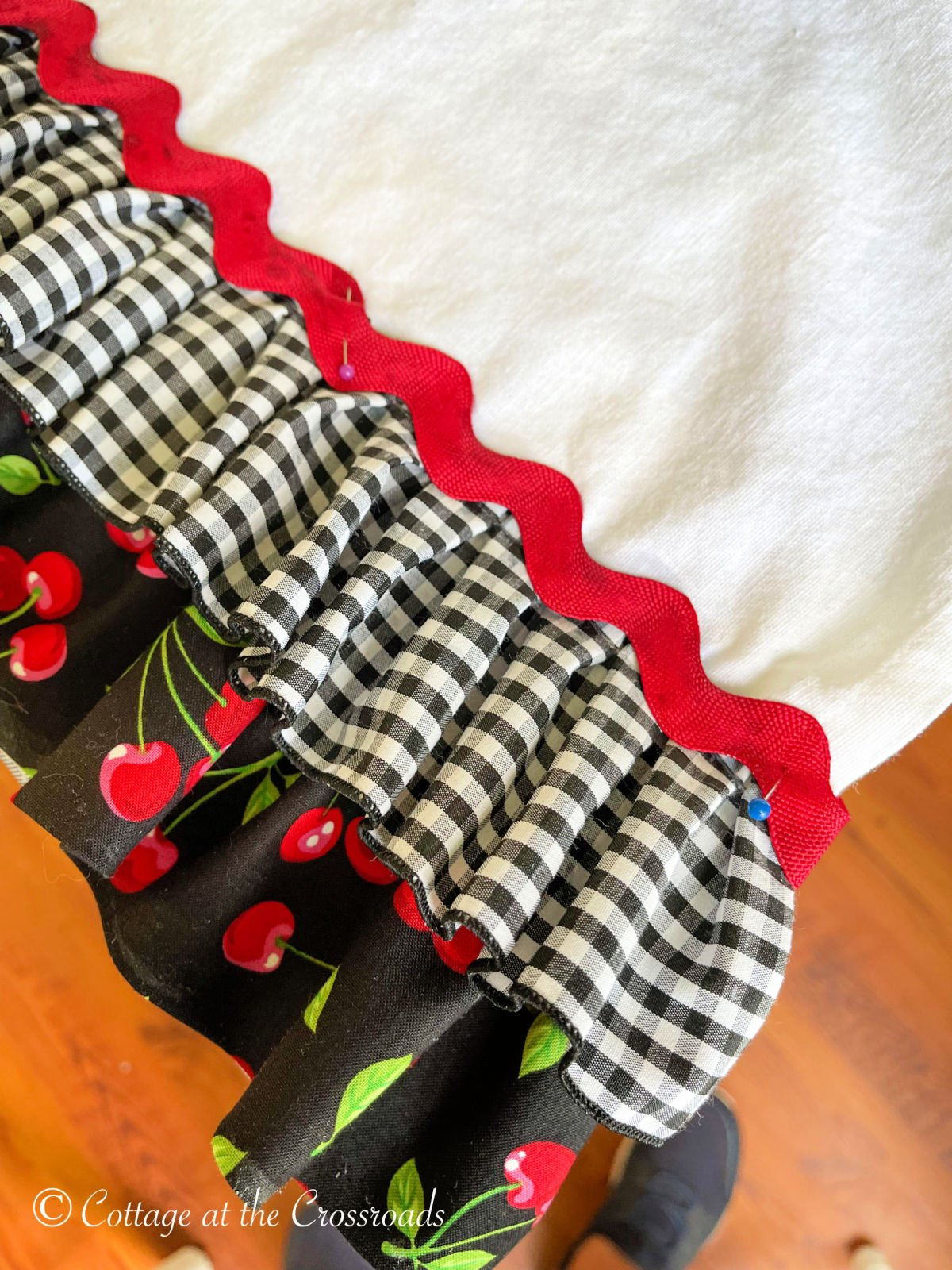red rick rack on top of ruffles on a tea towel